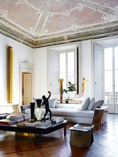 "House tour: a Milanese palazzo beautifully stripped back to its roots: It was two years ago when architect and sculptor Vincenzo de Cotiis and his wife, Claudia, discovered their 18th-century palazzo apartment in the old neighbourhood of Magenta. ""We'd previously lived in Brera, a very central, busy district,"" he explains. ""I'd always hoped to live in this area, but the right spaces are very hard to find. I wanted somewhere that retained original features, but still needed a lot of work."
