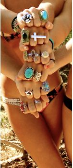 love all the rings with just a simple bathing suit! What a statement!
