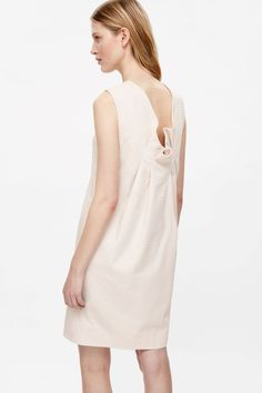 Dress with folded back