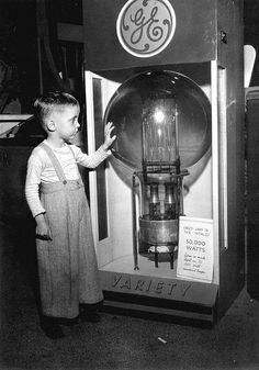 "1947; Tommy Dodgen, age 4, at ""the largest lamp in the world,"" Tampa, FL"
