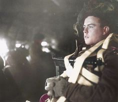"the_ww2_memoirs A young British paratrooper belonging to the 1st Airborne Division ""Red Devils"" ponders an unknown thought, most likely about his family or if he will be killed, as their aircraft fly towards their DZ outside of Arnhem, in the Netherlands, Operation Market Garden, September 17th, 1944. Despite my best efforts with research I couldn't find any more information and the fate of this young paratrooper is still unknown to this day. He is equipped with the Sten Pistol Mark V which…"