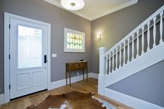 This newly renovated Edwardian, built in 1909 in the Inner Richmond, opens with a foyer that has an original banister and a newel post. Edwardian House, Newel Posts, Banisters, Gas Fireplace, Bay Window, Master Suite, Living Area, Foyer, Hardwood Floors