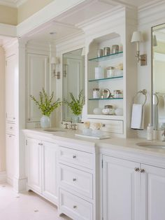 This spacious double vanity features a clean, white design with plenty of storage for your bathroom essentials. Nestled between the two mirrors, built-in glass shelves display decor and necessities in an elegant design.
