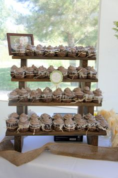 Perhaps a better way to get your cupcake without reaching deep into a circular type stand. Doesn't have to be so rustic, could prime and paint it bright white with personalized touches.