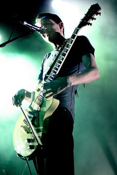 Sigur Ros - playing an electric guitar with a violin bow