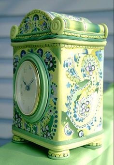clock made from a cookie tin covered in polymer clay. Upcycle recycle repurpose