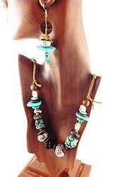 """Item NE 136 27"""" necklace, hangs shortest at 12 1/2"""" and is adjustabel with lobster claw clasp; silver plate chain with white turquoise magnesite stones, flat turquoise magnesite beads, wood beads, black agate stone, large silver finish beads, tan leather lace; 4"""" earrings, silver plate hooks $38.00"""