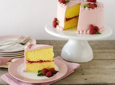 For special occasions, only a stand-out cake will do. Lemon-Raspberry Celebration Cake is easy to make but looks elegant and refined. Lemon-Raspberry Celebration Cake has layers of lemon cake, a raspberry filling and a light pink frosting. Good Desserts To Make, Fun Desserts, Delicious Desserts, Mothers Day Desserts, Raspberry Cake, Raspberry Filling, Strawberry, Raspberry Desserts, Raspberry Mousse