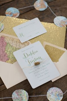 Travel inspired invite with map-lined envelopes. Oak & Orchid.