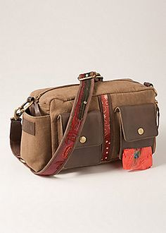 New & only @ Sahalie! Our Dog Lover's Bag holds both your stuff. Our dog-loving buyer designed this multi-tasking bag, so you and your best buddy can always be ready for a walk or frolic in the park.