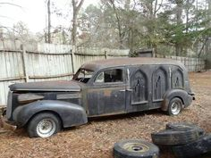 Old, rusted out Miller Art-Carved Hearse.