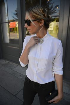 Buttoned with a Brooch via Cupcakes & Cashmere  - @Carina Street - I feel like this would make dress shirts more your style