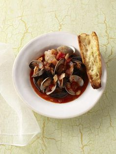 Mussels and Clams with Spicy Tomato Broth balance perfectly against entwine Pinot Grigio.