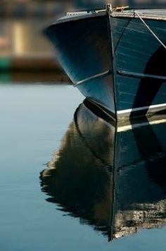 Reflection of a boat on still water