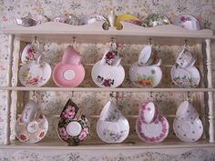 Tea Cup Collection! I would mix & match them against opposite plates. Mix & Match the whole display. Be very pretty.
