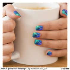 Nail wraps. Nebula green blue flames psychedelic minx. Designed for both fingers and toes Can last up to 1 week Includes two sheets of Minx nail coverings for a full manicure; package comes with eight nail coverings on each sheet in varying sizes Round portion of nail covering sits at the base of your nail Customize different designs on each sheet! The design on the largest covering of each sheet is applied to the remainder of the sheet. Please keep in mind varying nails sizes during design…