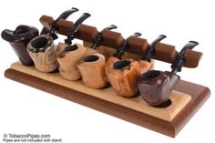 TobaccoPipes.com - Neal Yarm Mahogany and Maple 6-Pipe Stand, $128.00 (http://www.tobaccopipes.com/neal-yarm-mahogany-and-maple-6-pipe-stand/)