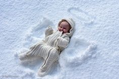 Not sure if I would put a baby in the snow... but this would be cute pose for the bigger kids :)