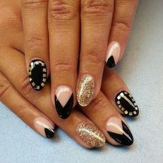 Oval shaped nails with black nude and gold designs