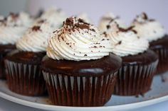 Irish Car Bomb cupcakes - Like the drink!!     Guinness infused caked dipped in Jameson chocolate ganache topped with Bailey's Irish Cream buttercream!