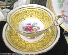 PARAGON YELLOW TEA CUP AND SAUCER FLOWERED*PAINTED**