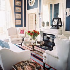 Preppy Navy Blue Blue is traditionally used to highlight architectural details. Painted panels topped by crisp white molding and gilded frames give this living room an ultra-preppy personality. Photography by Patrick Cline for Lonny house design design My Living Room, Home And Living, Living Spaces, Living Area, Coastal Living, Coastal Decor, Design Lounge, Navy Blue Walls, White Walls