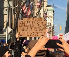 Funniest Women's March Signs From Around the World: Melanie: Blink Twice