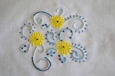 Sunshiny Day, neat use of fly stitch for the flowers!