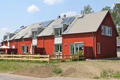 https://flic.kr/p/9Rp8Nu | Passive House - Öjersjö II | Garden side of energy efficient buildings with superinsulation. Primarily heated by radiated solar energy, heat produced by humans, household machinery, domestic electronic equipment and light fittings. Solar collectors on the roof for warm tap water. Painted with traditional red paint from the copper-mine in Falun (swedish: Falu rödfärg). A tenant-owners´ society with 28 dwellings. Built: 2010. Architect: Abako Arkitektkontor. <a…