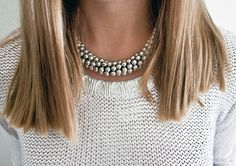 getting this length hair in january! plus i love her necklace and sweater.