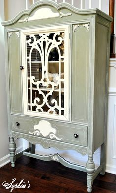 """White-Glazed Chateau Grey Cabinet...using """"chalk paint"""" you can take old pieces and turn them into new accents for your home. Add wooden accents and stencils for special touches."""