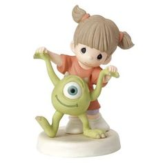"""Taking a walk, hand-in-hand with her not-so-scary friend, Mike Wazowski from Monsters Inc., a tiny tot already knows how special their friendship is. And even with one eye, Mike can see it, too! As they spend playtime together, they are sure to say, """"Eye love you,"""" every step of the way. Bisque porcelain. 5 1/4"""" H.  © Disney/Pixar"""