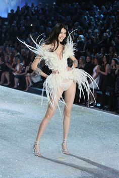 Victoria's Secret Fashion Show 2013 Pictures - Outfits (Vogue.com UK) - Angel Sui He showcases feathers and lace - the perfect vintage bridal combination.