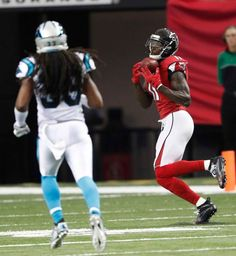 Atlanta Falcons wide receiver Julio Jones (11) makes a catch against the Carolina Panthers during the first half of an NFL football game, Sunday, Oct. 2, 2016, in Atlanta.
