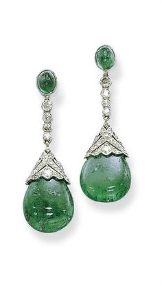 A PAIR OF ART DECO EMERALD AND DIAMOND EAR PENDANTS  Each suspending an emerald drop with a pierced single and circular-cut diamond cap, from a diamond collet line to the oval emerald surmount, mounted in platinum, circa 1920