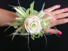 These magnificent roses will last you a lifetime. Forever rose Bouts and corsages. they come in a wide aray of colors to chose from. Designed by www.wildroseevents.com #wildroseevents #wedding #dallasflorist #foreverrose #bout #corsage #prom