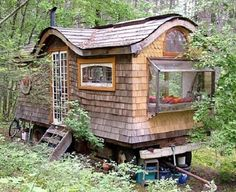 #1. This Gypsy Wagon in the woods is actually a tiny home built by Rachel Ross for less than $8,000.00.