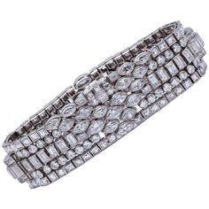 Superb Lacloche Frères Art Deco Diamond Platinum Bracelet Paris 1928. Lacloche Frères Art Deco Diamond Bracelet in Platinum. Created from numerous interconnected bezel set round, marquise, baguette, and French cut diamonds. Length 17.78cm x 2.28cm, 1920's