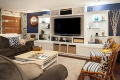 Sumptuous shag area rug in Basement Beach Style with Blue Accent Wall next to Built In Entertainment Center alongside Built In Wall Unit and Wall Unit Basement Entertainment Center, Diy Entertainment Center, Coral Throw Pillows, Blue Accent Walls, Layout, Buffalo Wings, Ikea Hacks, Decoration, New Homes