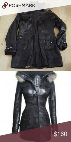 Women's Lady Top Gun Leather Pre-Owned women's brown leather jacket. There is a small rip by the right front pocket, other than that jacket is in great shape. Inside lining- beautiful lady Top Gun logo. Italian leather. Jacket runs small, fits more like a 2x. Front has a zip then an extra layer to button up jacket. Looks black in picture, but is really a chocolate brown. Miss Top Gun Jackets & Coats