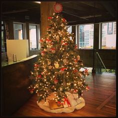 Getting into the #holiday spirit at #AmbitEnergy! Orange, white and silver #Christmas tree.
