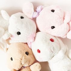 """These adorable plush rabbits are larger versions of the Pote Usa Loppy Pearl plushies and reproduce four of their excellent characters in a super cuddly """"big"""" size edition! Shiroppi (white rabbit with rainbow pearls), Ruby-chan (white albino rabbit with pearled pink bow),  Mimi-pyon (pink rabbit with pearled purple bow), and Chappy (beige rabbit with rainbow pearls) are all available in this even ..."""
