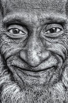 portrait smiling, wrinkled man.