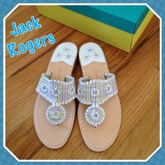 NWOTJack Rogers RARE plaid classic Navajo sandals NWOT (no box) Jack Rogers RARE classic Navajo sandals white pastel plaid with white leather stitching. All leather construction. The center band has a leather white whip stitch and plaid pastel (blue, yellow, pink, white). Sandal size is written on the inside of the shoe. Love them!  ❤️ Jack Rogers Shoes Sandals