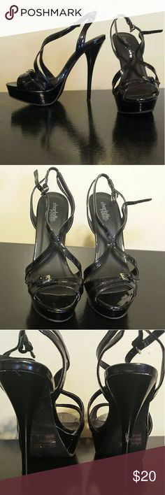 "Charlotte Russe TALL black open toed stilettos. This black open-toed tall stiletto heels have only been worn once or twice but was purchased with the defect on back heel. It can easily be filled in with black paint or a Sharpie. Heels about 4"" in height. Charlotte Russe Shoes Heels"