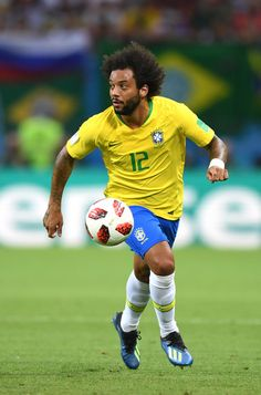 Marcelo Photos - Marcelo of Brazil runs with the ball during the 2018 FIFA World Cup Russia Quarter Final match between Brazil and Belgium at Kazan Arena on July 2018 in Kazan, Russia. Belgium: Quarter Final - 2018 FIFA World Cup Russia Brazil Football Team, Football Boys, World Cup 2018, Fifa World Cup, Mc 12, Lionel Messi, Fc Barcelona, Football Players, Sports