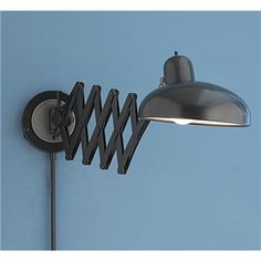"""Accordion Modern Swing Arm Wall Sconce  An accordion arm extends out and rotates left to right and up and down. A extremely functional swing arm with lots of style to boot. Finished in a satin black, this swing arm is sold as a pin-up but easily converts to a hardwire fixture. Convertible wiring.   60 watts. (medium base socket)  (5""""Hx33"""" Fully extended)  5"""" round backplate  2x12"""" rod sections   Product SKU: WS11001 BK  Price:  $169.00"""