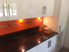 Pure orange with a Mirror Stripe- Glass Kitchen Splashback #kitchen #modernkitchen