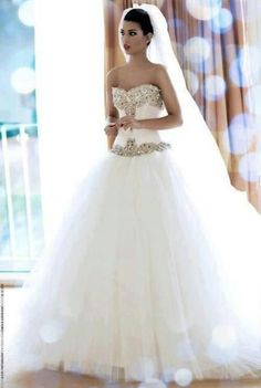 Stunning, drop waist, ball gown style wedding dress. With heavily crystal beaded top and tulle bottom.