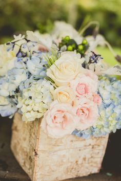 Blue hydrangeas, light pink + ivory roses in distressed wooden boxes {Chris Sosa Photography}